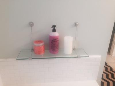 Cute glass shelf for tub necessities.